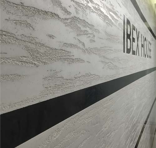 Dragged: Dragged Polished Plaster with banding and logo at Ibex House, London